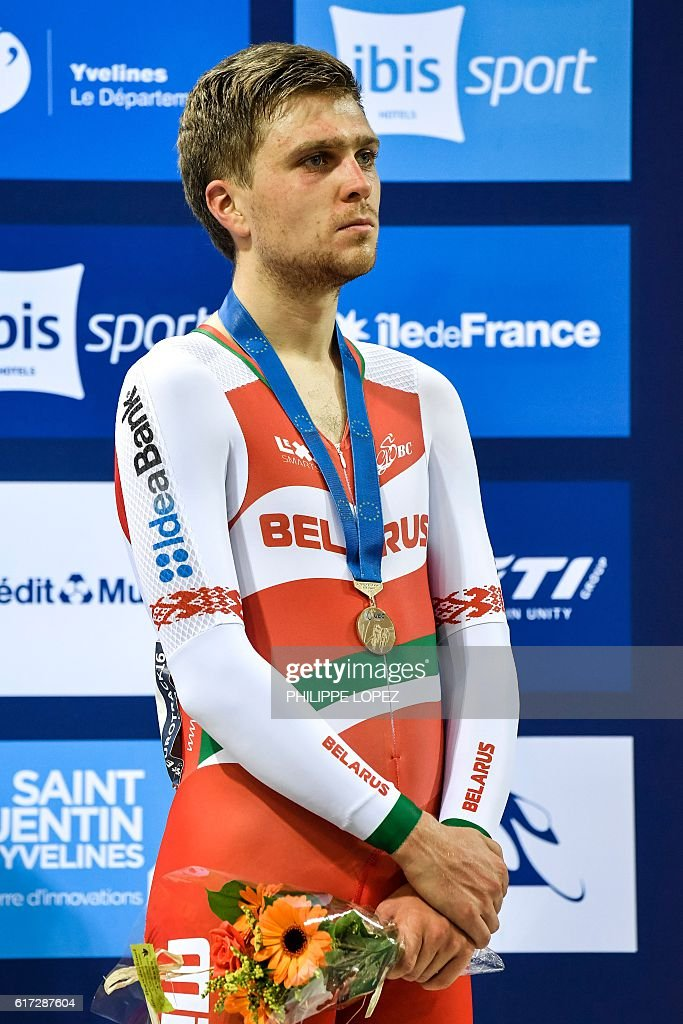 Bronze medallist Belarussian Raman Ramanau stands on the podium of the points race at the European Track Championships Saint Quentin en Yvelines on October 22, 2016. / AFP / PHILIPPE