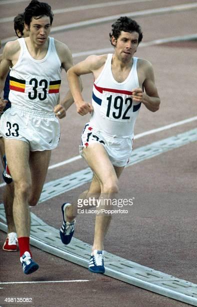 Bronze medallist Brendan Foster of Great Britain leads Gilbert van Manshoven of Belgium in the first heat of the men's 1500 metres event during the...
