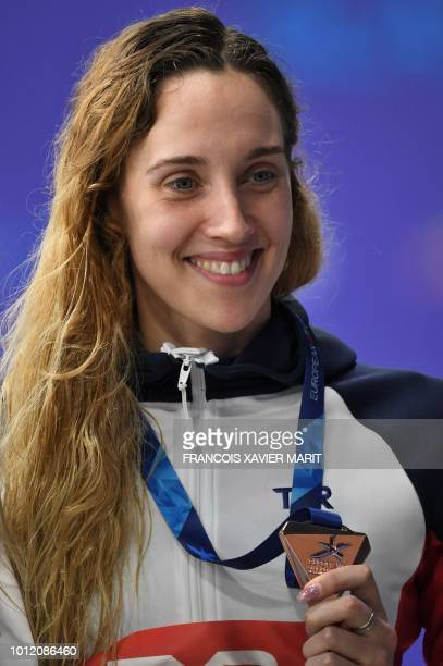 Bronze medallist Britain's Alys Thomas poses on the podium during the medal ceremony for the Women's 200m butterfly swimming final at the Tollcross...