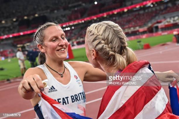 Bronze medallist Britain's Holly Bradshaw and gold medallist USA's Katie Nageotte celebrate after the women's pole vault final during the Tokyo 2020...