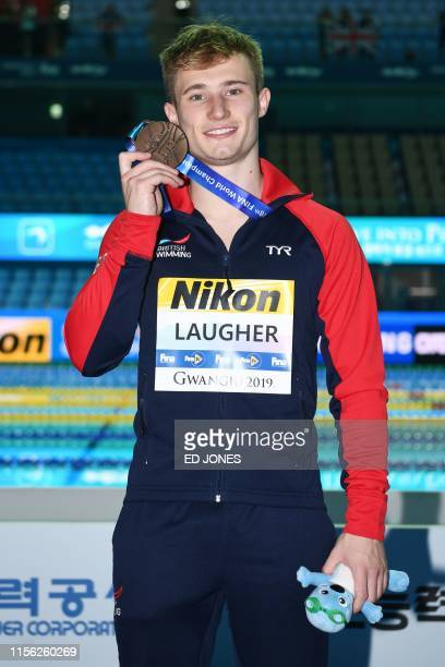 Bronze medallist Britain's Jack Laugher celebrates during the medals ceremony of the men's 3m springboard diving final during the 2019 World...