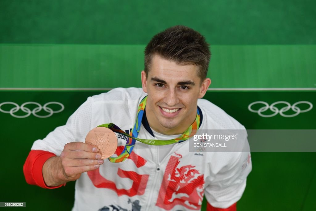 TOPSHOT - Bronze medallist Britain's Max Whitlock poses with his medal after the men's individual all-around final of the Artistic Gymnastics at the Olympic Arena during the Rio 2016 Olympic Games in Rio de Janeiro on August 10, 2016. / AFP PHOTO / Ben STANSALL