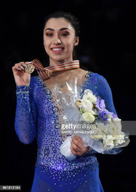Bronze medallist Canada's Gabrielle Daleman poses with her medal on the podium after the woman's Free Skating event at the ISU World Figure Skating...