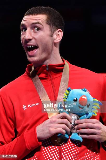 Bronze medallist Canada's Harley O'Reilly attends the medal ceremony for the men's 81kg boxing event during the 2018 Gold Coast Commonwealth Games at...