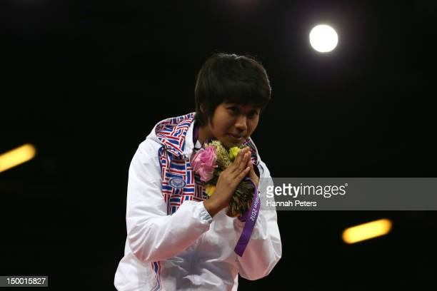 Bronze medallist Chanatip Sonkham of Thailand celebrates during the medal ceremony for the Women's 49kg Taekwondo on Day 12 of the London 2012...
