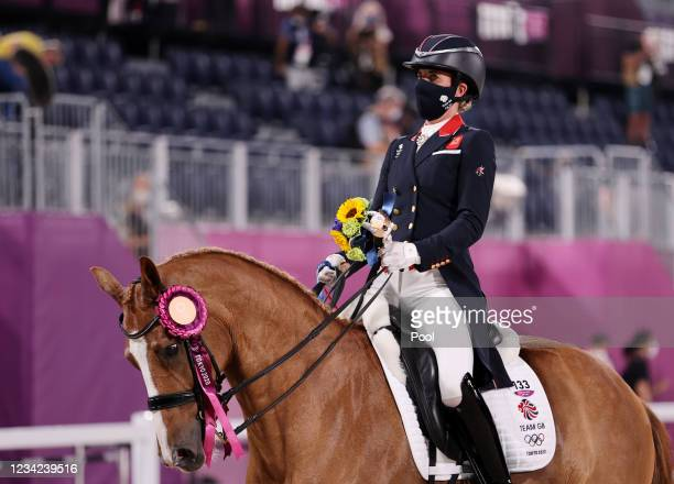 Bronze medallist Charlotte Dujardin of Britain ride on the course after the medal ceremony on day four of the Tokyo 2020 Olympic Games at Equestrian...