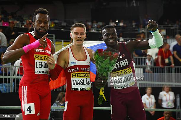 Bronze medallist Deon Lendore of Trinidad and Tobago gold Pavel Maslak of the Czech Republic and silver medallist Abdalelah Haroun of Qatar celebrate...