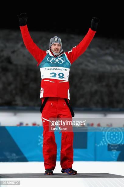 Bronze medallist Dominik Landertinger of Austria celebrates during the victory ceremony for the Men's 20km Individual Biathlon at Alpensia Biathlon...