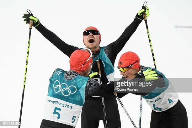 Bronze medallist Eric Frenzel of Germany congratulates gold medallist Johannes Rydzek of Germany as silver medallist Fabian Riessle of Germany...