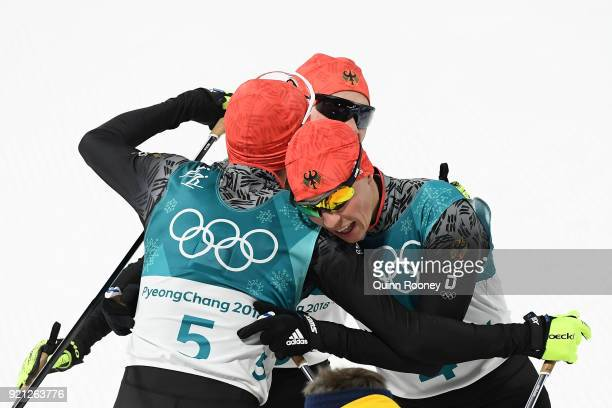 Bronze medallist Eric Frenzel of Germany congratulates gold medallist Johannes Rydzek of Germany during the Nordic Combined Individual Gundersen 10km...