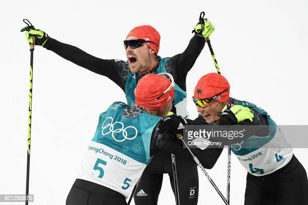 Bronze medallist Eric Frenzel of Germany congratulates gold medallist Johannes Rydzek of Germany as silver medallist Fabian Riessle of Germany...