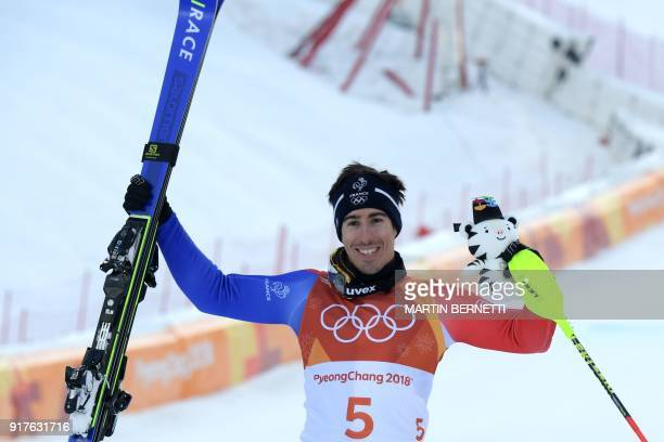 Bronze medallist, France's Victor Muffat-Jeandet, celebrates during the victory ceremony of the Men's Alpine Combined at the Jeongseon Alpine Center...