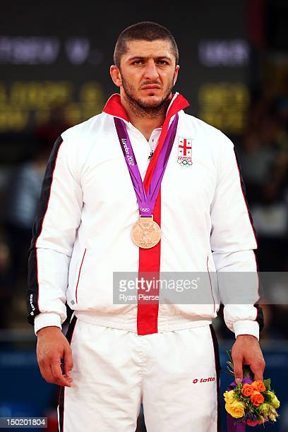 Bronze medallist George Gogshelidze of Georgia celebrates with his medal during the medal ceremony following the Men's Freestyle 96 kg Wrestling gold...