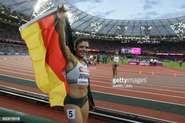 Bronze medallist Germany's Pamela Dutkiewicz celebrates after the women's 100m hurdles athletics event at the 2017 IAAF World Championships at the...