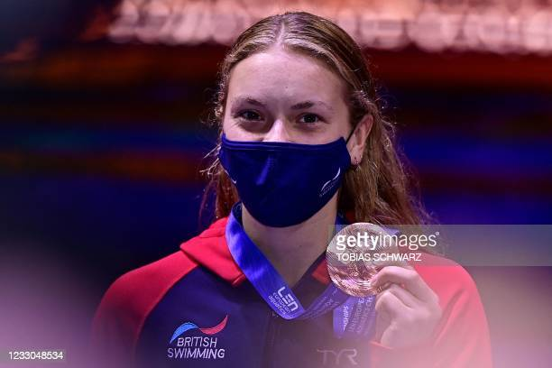 Bronze medallist Great Britain's Anna Hopkin poses during the podium ceremony after the final of the Womens 100m Freestyle Swimming event during the...