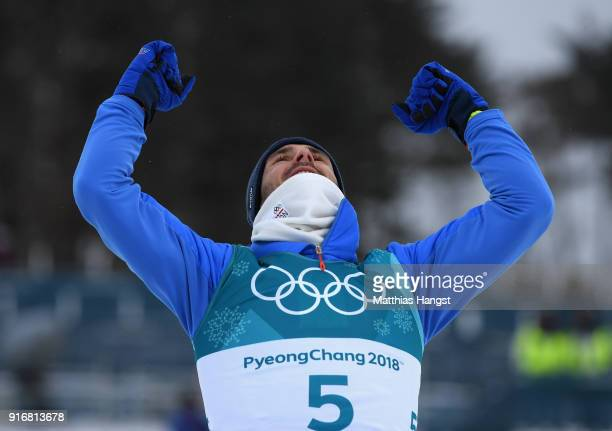 Bronze medallist Hans Christer Holund of Norway celebrates during the victory ceremony after the Men's 15km and 15km Skiathlon CrossCountry Skiing on...