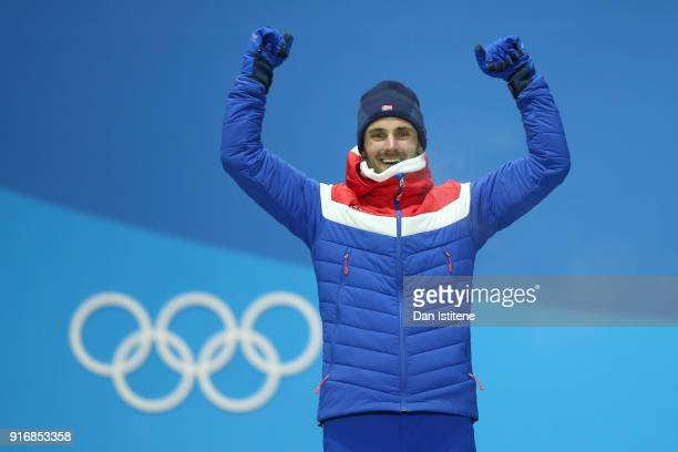 Bronze medallist Hans Christer Holund of Norway celebrates on the podium during the Medal Ceremony for the Men's CrossCountry Skiing 15 km 15 km...
