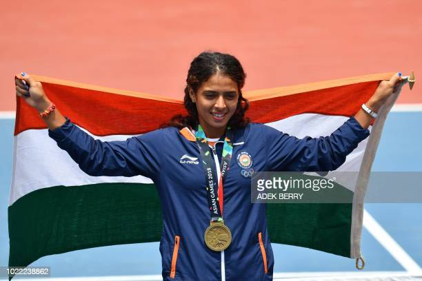 Bronze medallist India's Ankita Ravinderkrishan Raina poses with her national flag during the medal ceremony for the women's singles tennis event at...