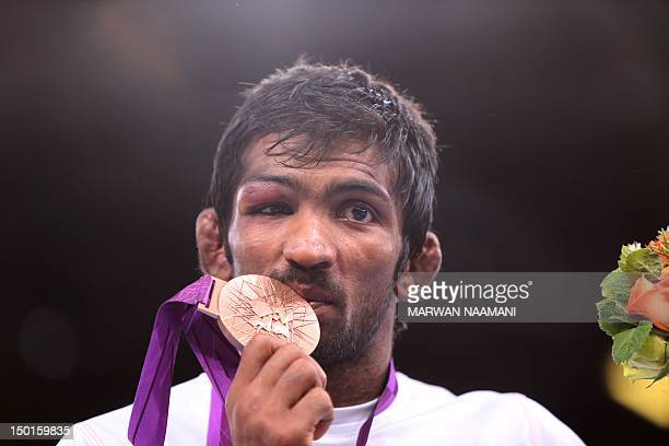 Bronze medallist India's Yogeshwar Dutt kisses his medal on the podium of the Men's 60kg Freestyle on August 11 2012 during the wrestling event of...