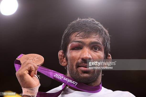 Bronze medallist India's Yogeshwar Dutt poses on the podium of the Men's 60kg Freestyle on August 11 2012 during the wrestling event of the London...