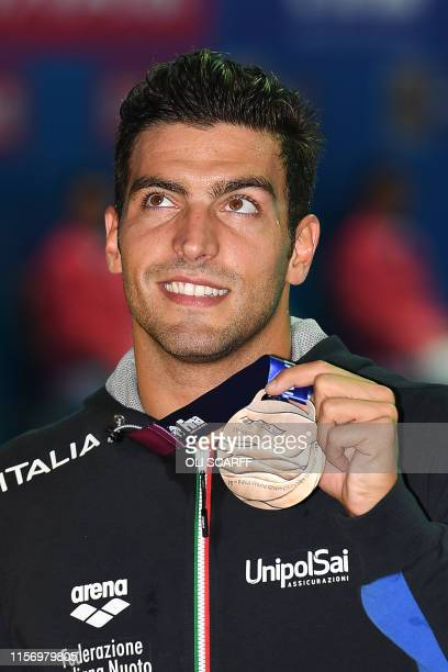 Bronze medallist Italy's Gabriele Detti poses with his medal after the final of the men's 400m freestyle event during the swimming competition at the...