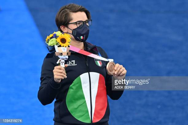 Bronze medallist Italy's Lucilla Boari poses during the women's individual victory ceremony during the Tokyo 2020 Olympic Games at Yumenoshima Park...
