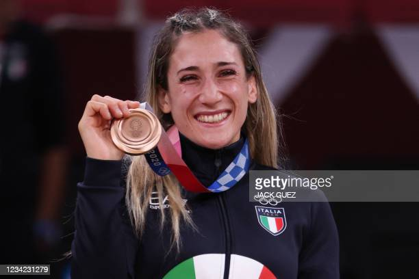 Bronze medallist Italy's Maria Centracchio celebrates during the medal ceremony for the judo women's -63kg contest during the Tokyo 2020 Olympic...