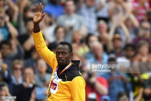 Bronze medallist Jamaica's Usain Bolt poses during the victory ceremony for the men's 100m athletics event at the 2017 IAAF World Championships at...