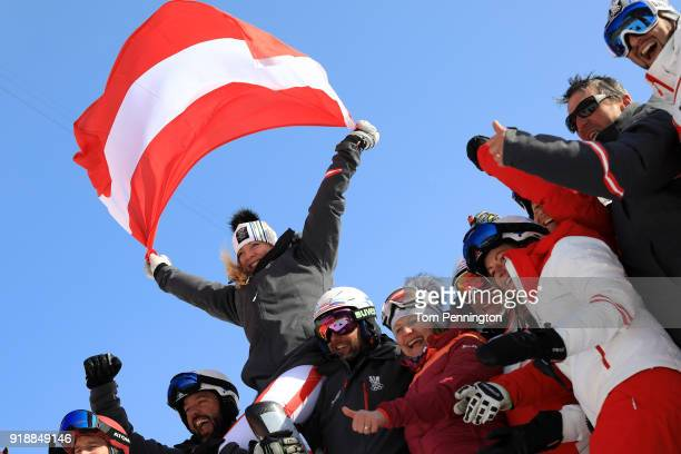 Bronze medallist Katharina Gallhuber of Austria celebrates with her team during the victory ceremony for the Ladies' Slalom Alpine Skiing at...