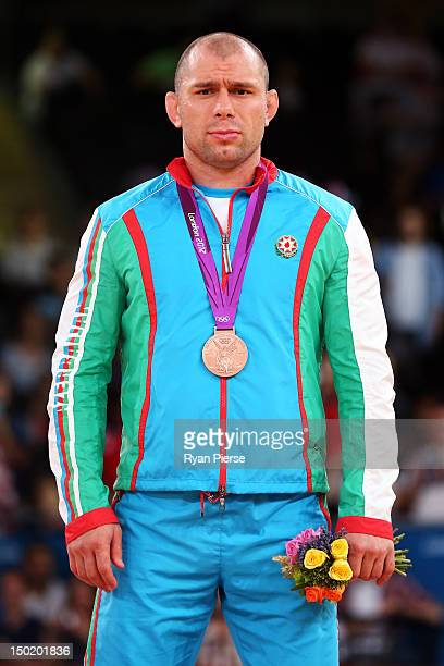 Bronze medallist Khetag Gazyumov of Azerbaijan celebrates with his medal during the medal ceremony following the Men's Freestyle 96 kg Wrestling gold...