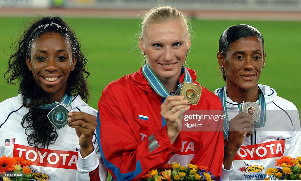 Bronze medallist Lashinda Demus of the United States, gold medallist Yuliya Penchonkina of Russia and Sandra Glover of the United States pose with medals during the womens' 400-meter hurdle medal ceremony at the IAAF World Championships in Athletics at Olympic Stadium in Helsinki, Finland on Sunday, August 14, 2005.