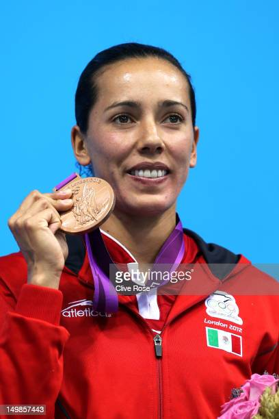Bronze medallist Laura Sanchez Soto poses on the podium in the medal ceremony for the Women's 3m Springboard Diving final on Day 9 of the London 2012...