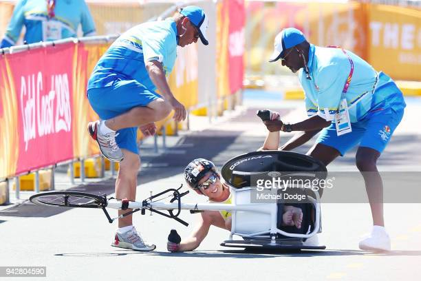 Bronze medallist Lauren Parker of Australia crashes in the straight before the finish line during the Women's PWTC Triathlon on day three of the Gold...