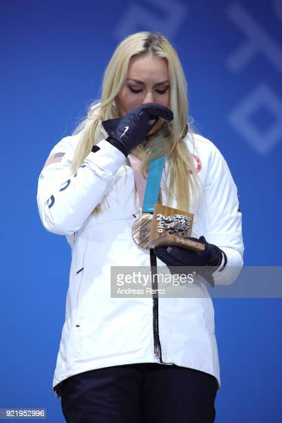 Bronze medallist Lindsey Vonn of the United States celebrates during the medal ceremony for the Ladies' Downhill on day twelve of the PyeongChang...