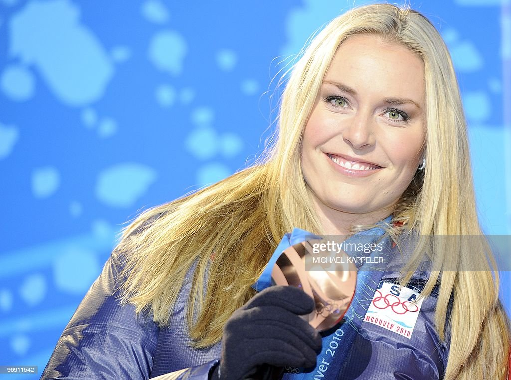 US bronze medallist Lindsey Vonn poses for photographers during the medal ceremony for the Alpine skiing Women's Super-G event of the Vancouver 2010 Winter Olympics at Whistler Medal Plaza venue on February 20, 2010 in Whistler.