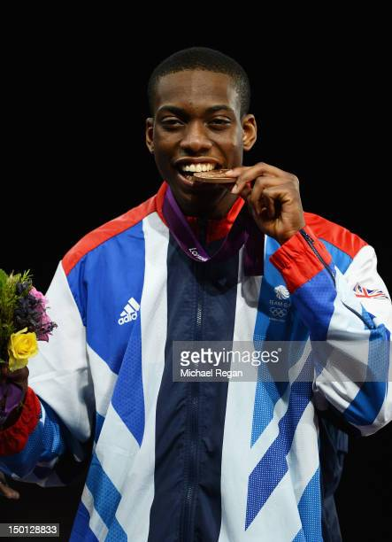 Bronze medallist Lutalo Muhammad of Great Britain celebrates during the medal ceremony in the Men's 80kg Taekwondo on Day 14 of the London 2012...