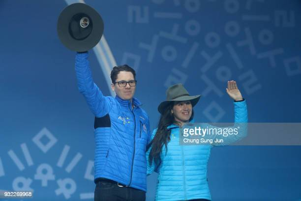 Bronze medallist Melissa Perrine of Australia and her guide Christian Geiger celebrate on the podium during the medal ceremony for the Alpien Skiing...