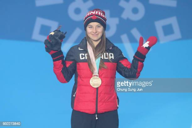 Bronze medallist Mollie Jepsen of Canada celebrates on the podium during the medal ceremony for the Alpien Skiing Women's Gaint Slalom Standing on...