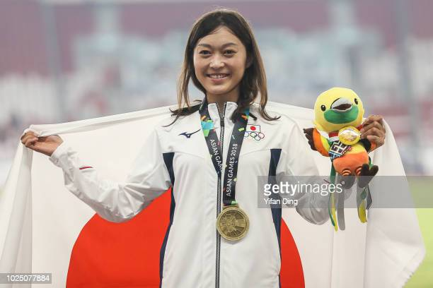 Bronze medallist Okada Kumiko of Japan pose for photo during Athletics WomenÕs 20km Race Walk medal ceremony at GBK Main Stadium on day eleven of the...