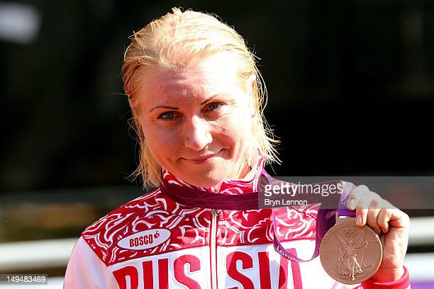 Bronze medallist Olga Zabelinskaya of Russia celebrates during the Victory Ceremony after the Women's Road Race Road Cycling on day two of the London...