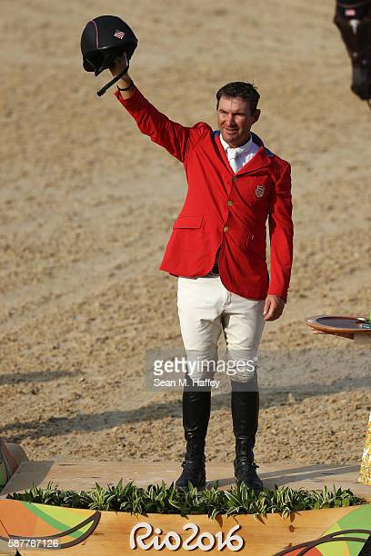 Bronze medallist Phillip Dutton of the United States pose during the medal ceremony for the eventing team Individual final on Day 4 of the Rio 2016...