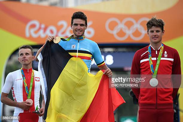 Bronze medallist Poland's Rafal Majka Gold medallist Belgium's Greg Van Avermaet and silver medallist Denmark's Jakob Fuglsang pose on the podium...