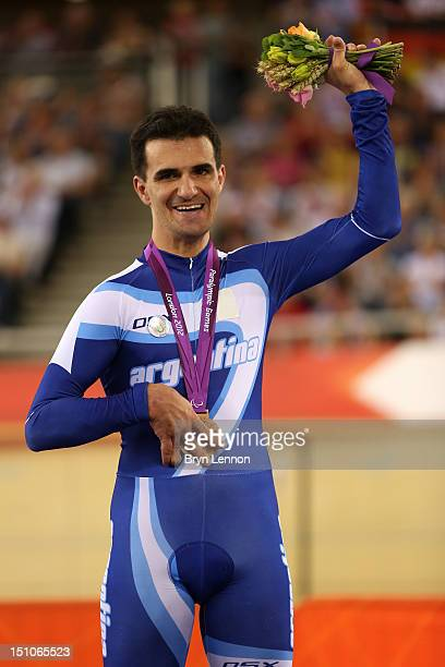 Bronze medallist Rodrigo Lopez of Argentina poses on the podium during the medal ceremony for the Men's Individual Cycling C1 Pursuit final on day 2...