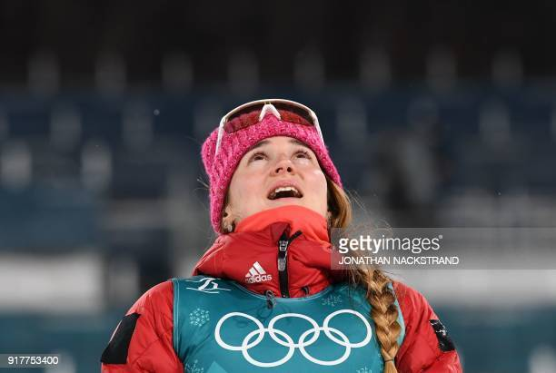 Bronze medallist Russia's Yulia Belorukova reacts on the podium during the victory ceremony in the women's crosscountry individual sprint classic...