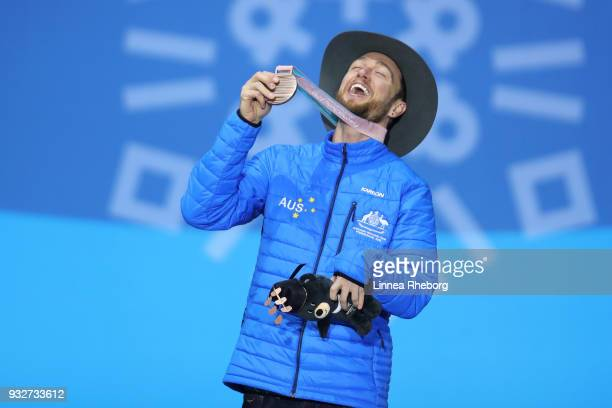 Bronze medallist Simon Patmore of Australia celebrates during the medal ceremony for the Men's Snowboard Banked Slalom SBUL Final on day seven of the...