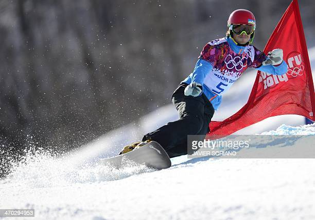 Bronze Medallist Slovenia's Zan Kosir competes in the Men's Snowboard Parallel Giant Slalom Final at the Rosa Khutor Extreme Park during the Sochi...