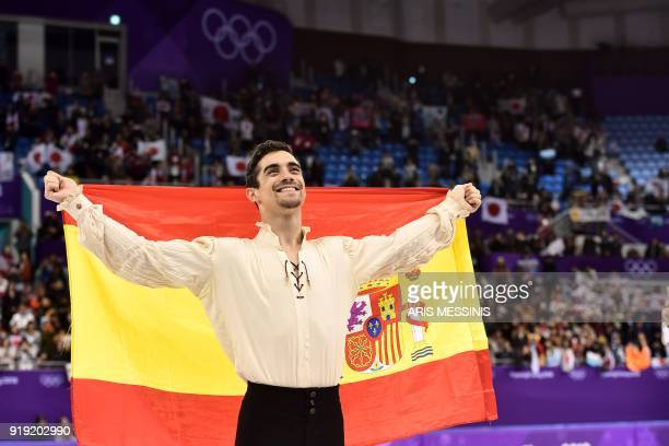 TOPSHOT Bronze medallist Spain's Javier Fernandez poses with his national flag during the venue ceremony after the men's single skating free skating...