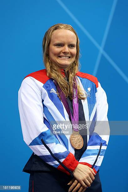 Bronze medallist Susannah Rodgers of Great Britain pose on the podium during the medal ceremony for the Women's 100m Freestyle S7 final on day 5 of...