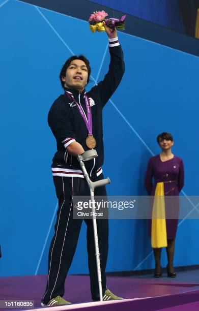Bronze medallist Takayuki Suzuki of Japan poses on the podium during the medal ceremony for the Men's 150m Individual Medley SM4 final on day 4 of...