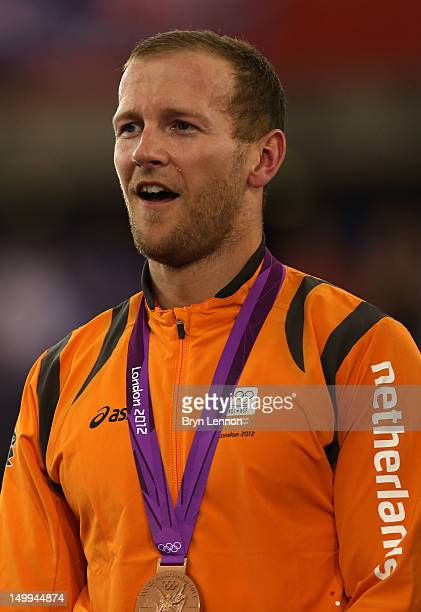Bronze medallist Teun Mulder of the Netherlands celebrates during the medal ceremony for the Men's Keirin Track Cycling Final on Day 11 of the London...
